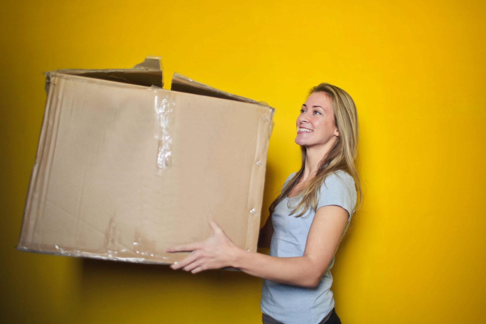 Girl moving boxes to new location