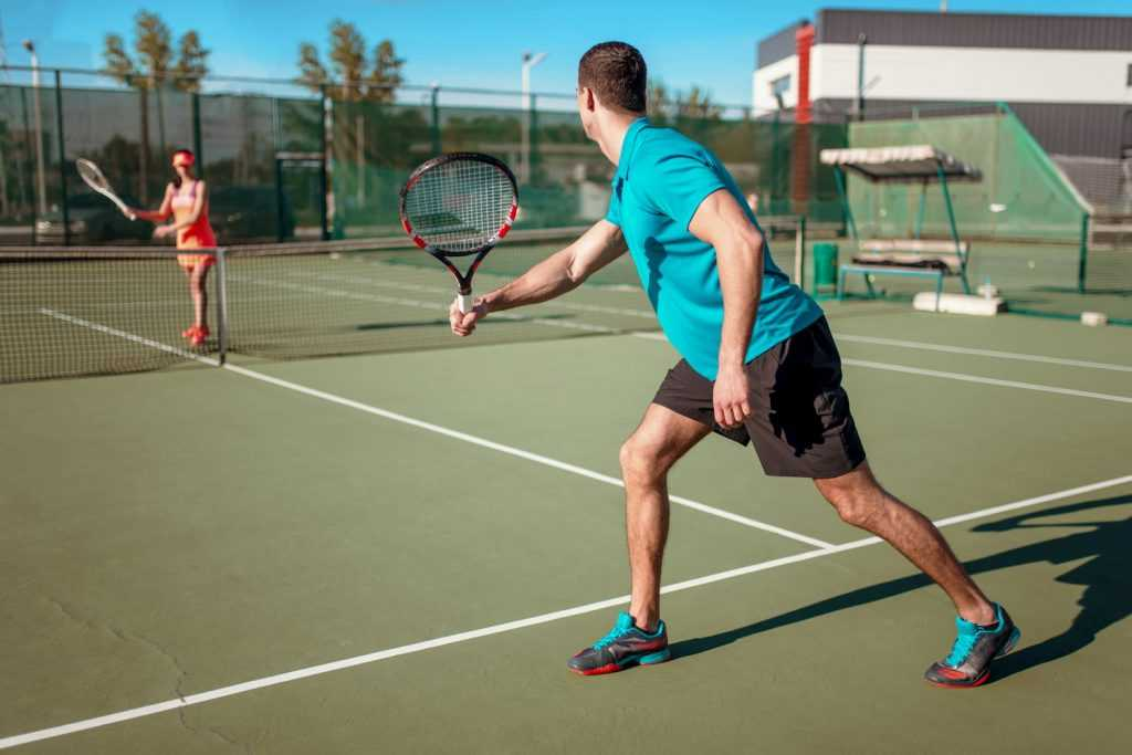 outdoor-adventures-couple-playing-tennis