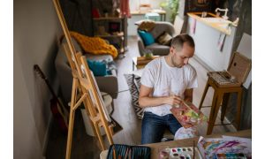 man painting improving skills you can learn from your apartment