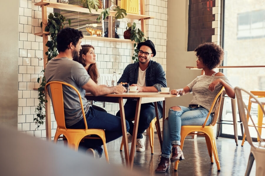friends meeting up at a DC coffee shop