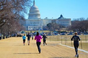 Joggers on a sunny day outside Washington, D_C_'s National Mall, one of the best places to run in the city_
